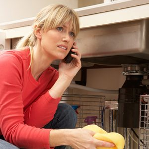 top_dog_plumbing_eagle_blog_page_woman_on_phone